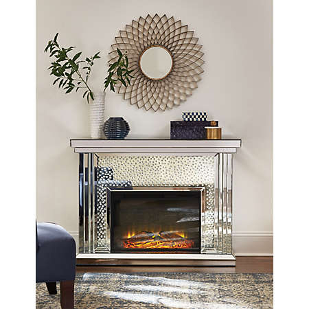 Add some warmth and glamour with the Krystal Fireplace Collection. This beautiful mirrored mantel will make a statement piece in any space.