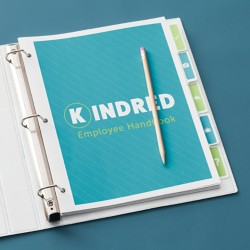 Use binders and dividers for a more flexible way to update information in employee handbooks than bound books.