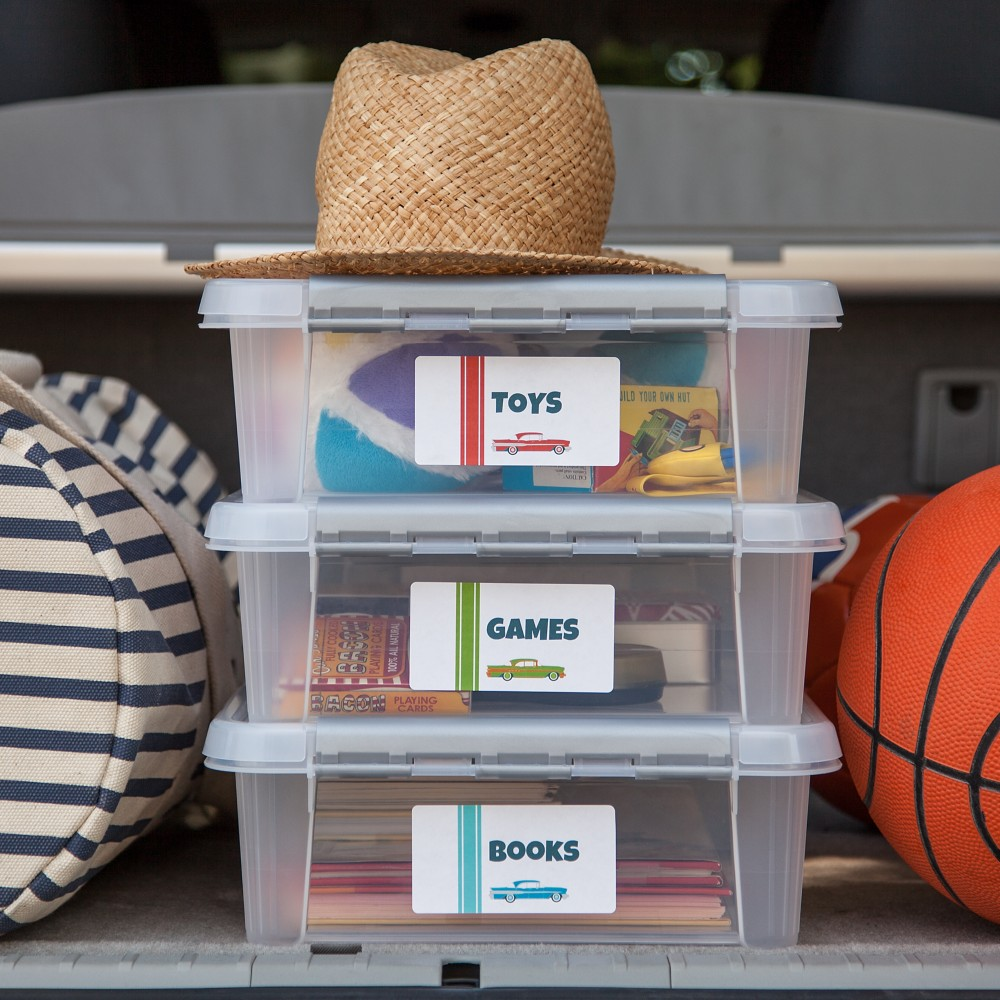 Books, small toys, card games and travel games are easy to take along on the trip in organized bins.
