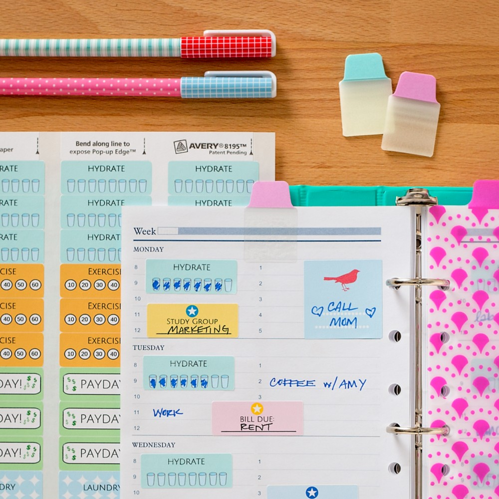Colorful reminder stickers and tabs capture your attention on your calendar.