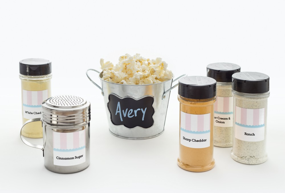 Create decorations to match the shower theme and all your party pieces will fit right in, like these popcorn seasoning square labels designed on Avery Design & Print.