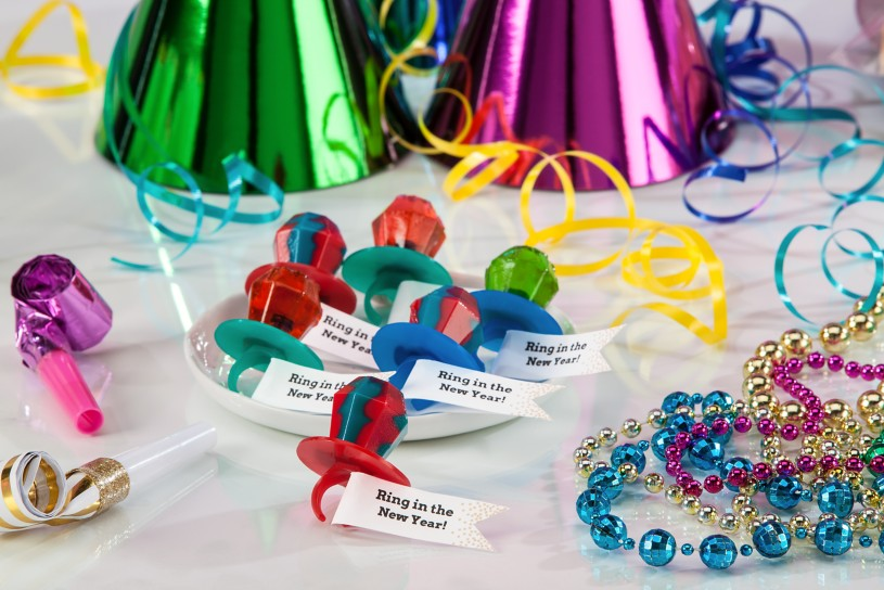 Create custom favors by attaching adhesive flags to ring candy.