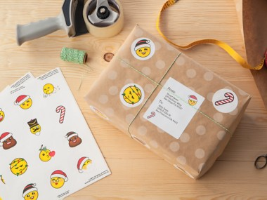 Holiday-themed round emoticons decorate the shipping package