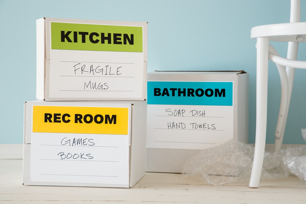 Label boxes by room.