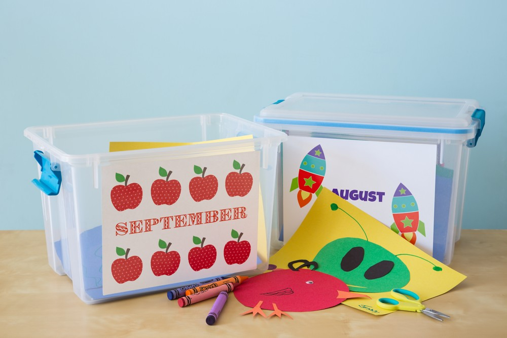Craft bins organized by month using full-sheet labels make it easy to keep supplies together.