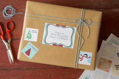 Holiday-themed square labels decorate the shipping package