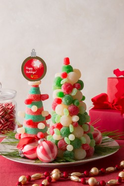 Add the perfect finishing touch to topiaries and treats with holiday toppers! Make your own custom toppers with our step-by-step guide.