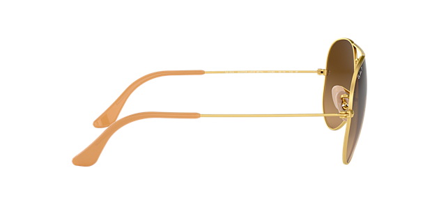 ray ban rb3025 iconic aviator sunglasses  the polarized, brown lenses combine with size 58mm gold, large metal aviator frame.