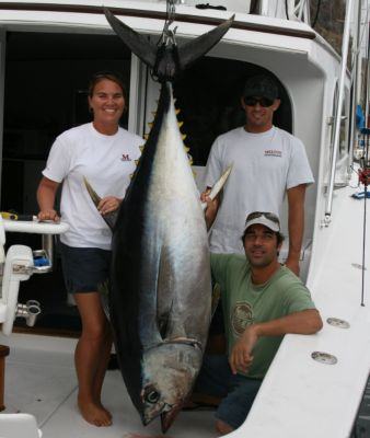 Jess Kelmer, Jonboy Kelmer and Melton Tackle friend Antony Haji pose with a 227 lb. Bigeye Tuna