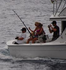 The Grander backs down while wireman extraordinaire Bo Jeyns takes wraps on an 800 lb. class Blue Marlin.