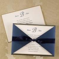 gold border invitation with ribbon