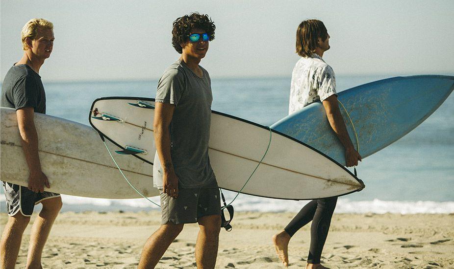 Guys surf with Sandbank sunglasses