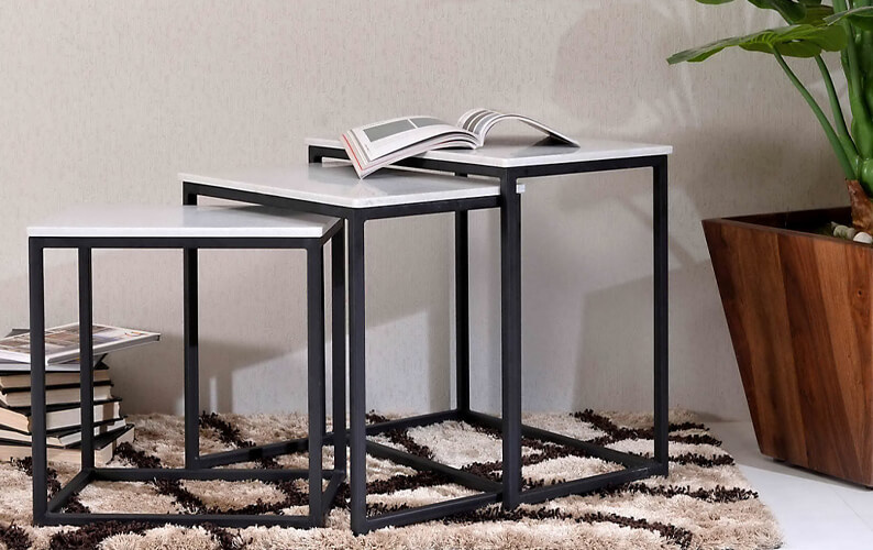 Set of three white marble nesting tables with black metallic frames