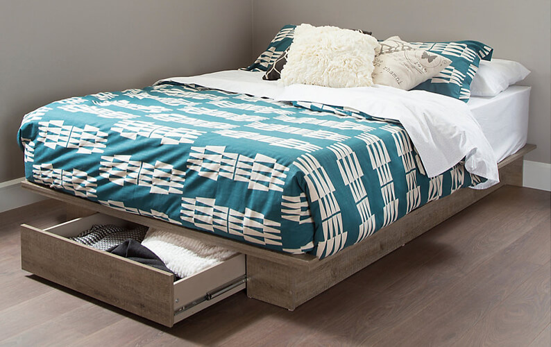 Medium wood bed with front storage drawer and teal and white bedding