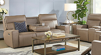 Tan reclining sofa with rectangular wood coffee table atop a white area rug