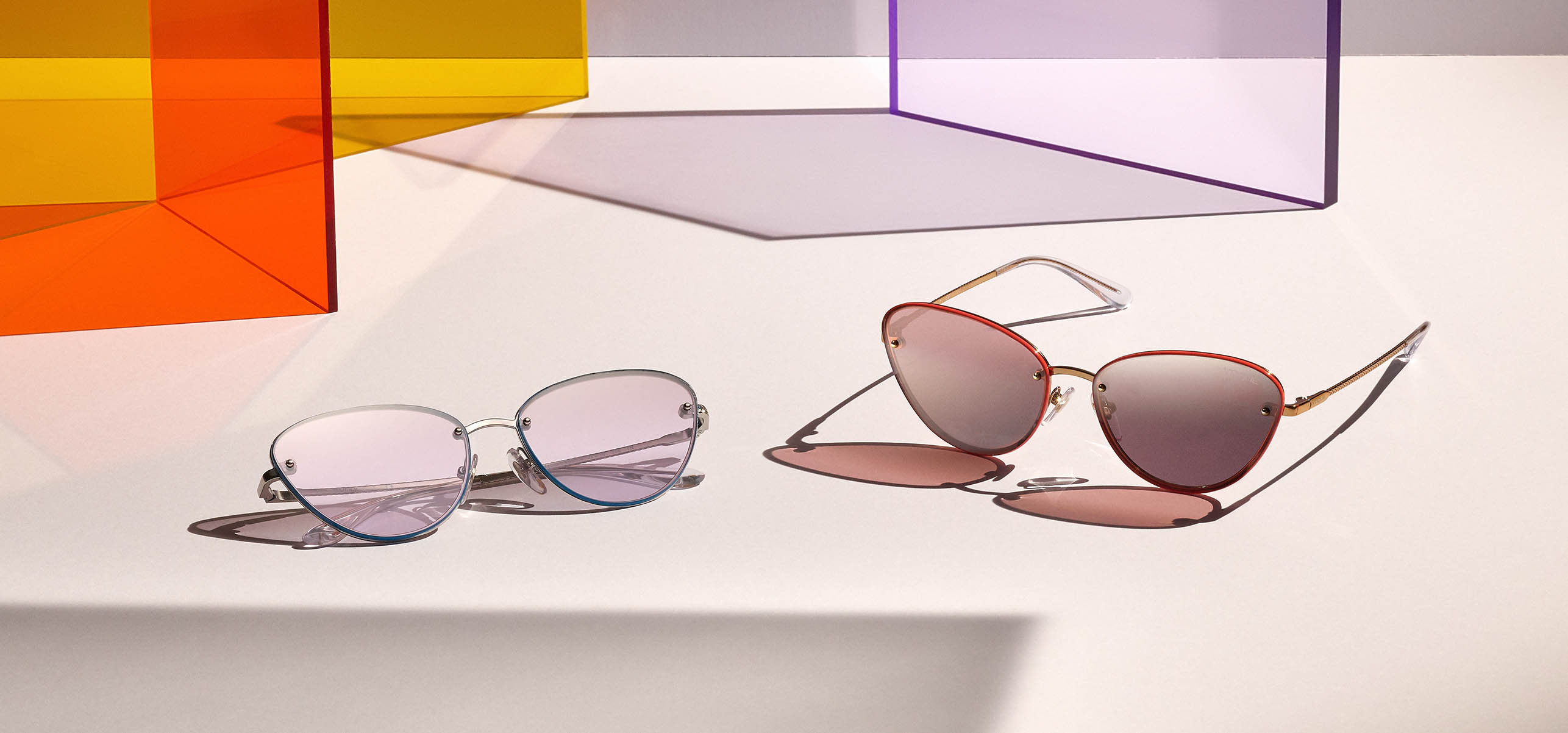 78929b79da21 A captivating rimless cat-eye shape gets a new feminine twist with edgy  color profiles.